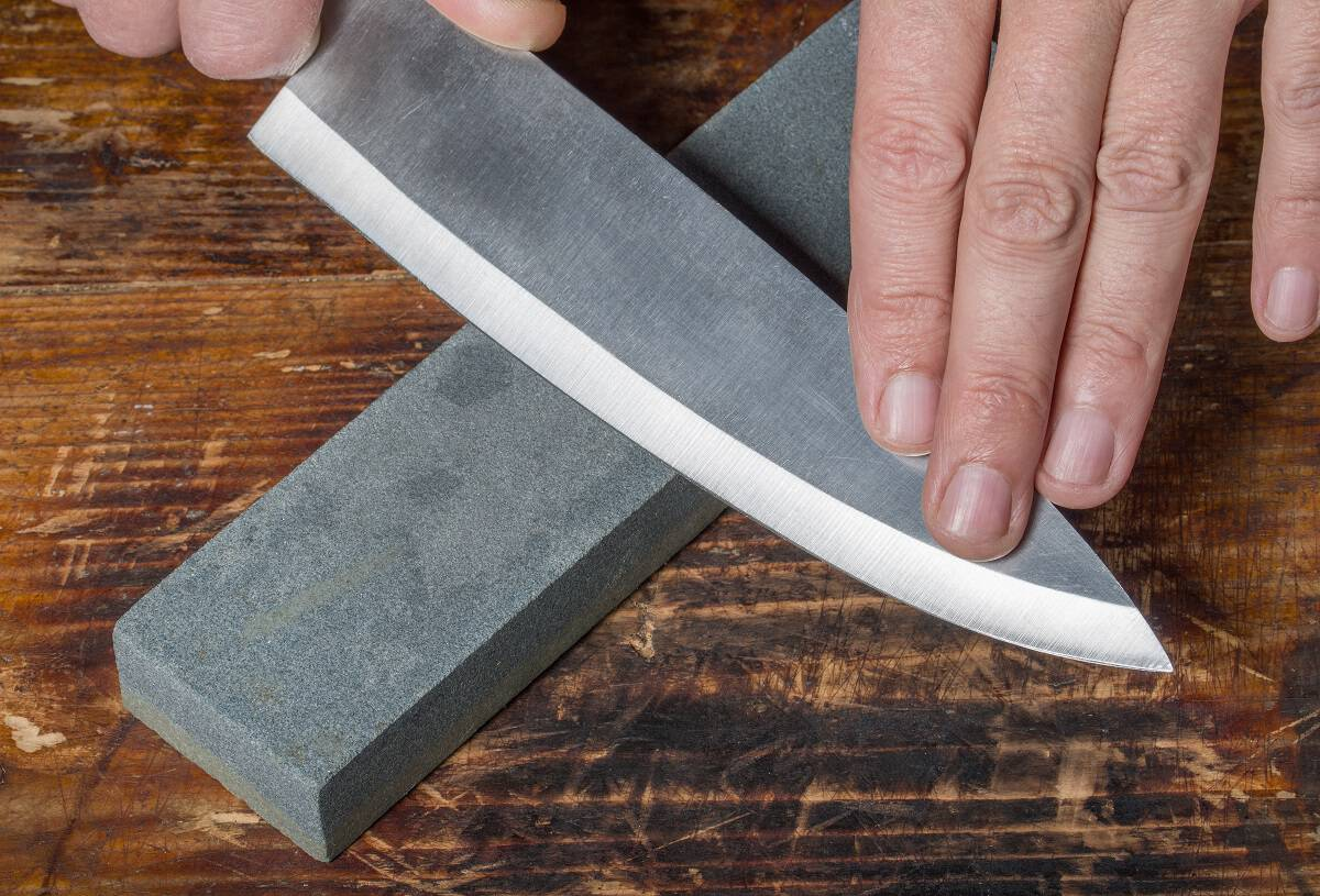 sharpen a knife with a sharpening stone